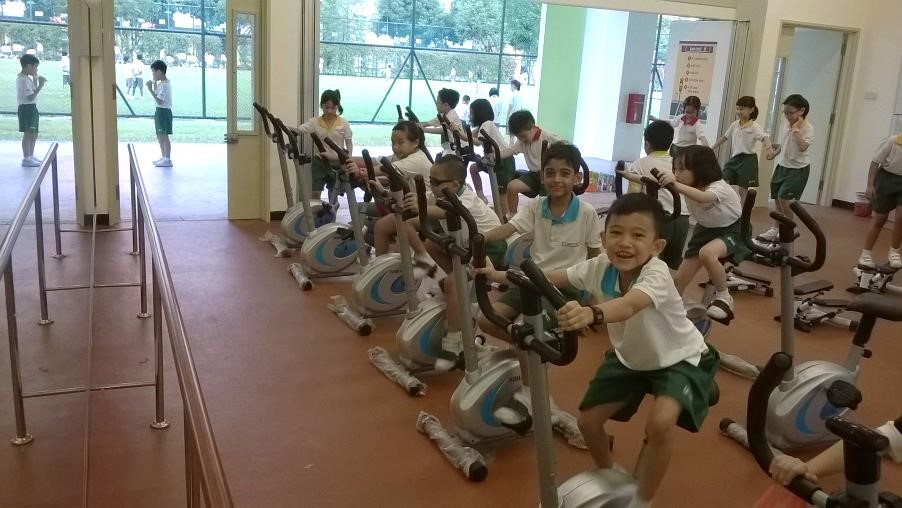 Students use gym equipment for exercising.jpg
